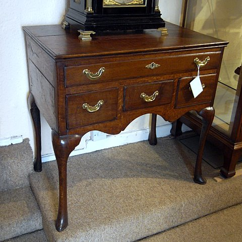 Click here to see more detail of an 18th century oak four drawer lowboy