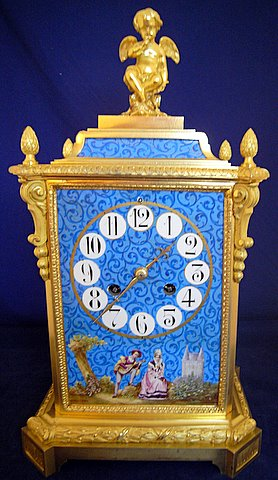 19th century French gilt ormolu mantel clock painted porcelain panels