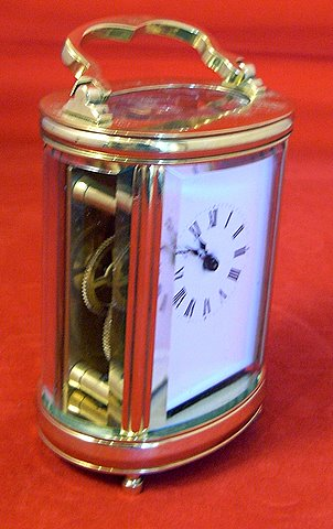 Miniature carriage clock oval case eight day timepiece - angle