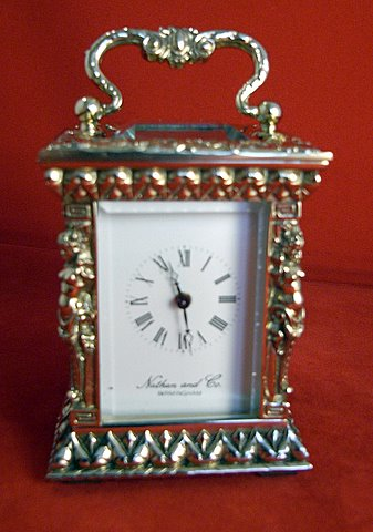 Miniature carriage clock with caryatid columns